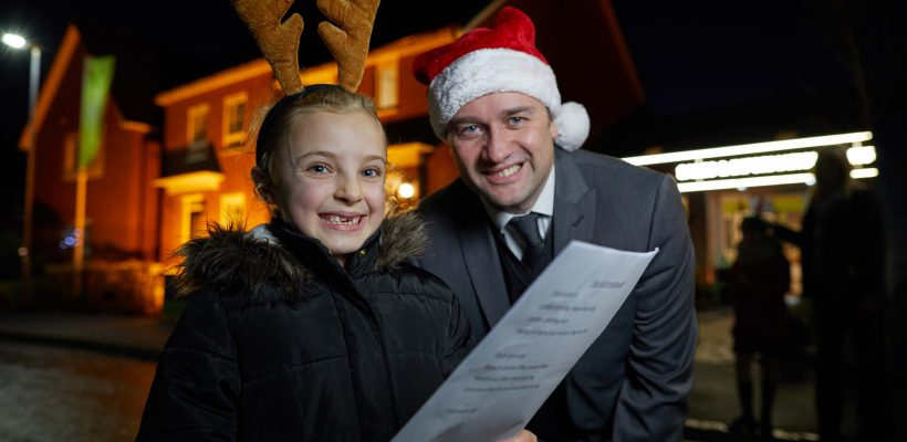 Barratt Tarleton Locks, Plox Brow, PRESTON  Barratt has invited local primary school to sing Christmas carols at its development to celebrate first xmas for most residents  Pictured Milly Johnson aged 7 with Barratt sales adviser Lee Bowers
